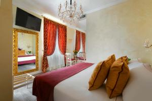 A bed or beds in a room at Relais Empire