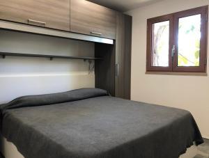 Letto o letti in una camera di Village Camping Santa Fortunata - Campogaio