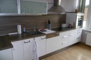 A kitchen or kitchenette at Villa Greve - Maisonette Suite