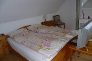A bed or beds in a room at Villa Greve - Maisonette Suite
