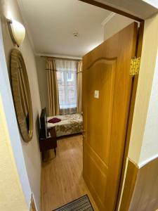 Кровать или кровати в номере Гостиница Мирабель