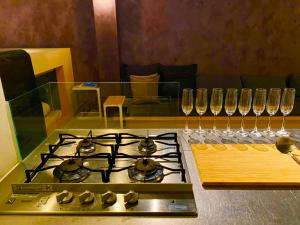 A kitchen or kitchenette at O3 Hostel & Apartment