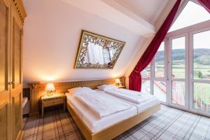 Ein Bett oder Betten in einem Zimmer der Unterkunft Göbels Hotel zum Löwen