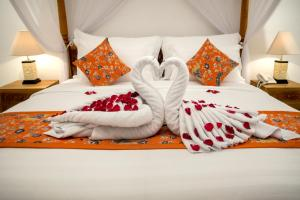 A bed or beds in a room at Sandi Agung Villa Bidadari