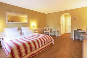 Cama o camas de una habitación en Blesius Garten