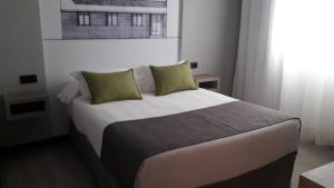 A bed or beds in a room at Hotel Parque