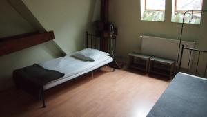 Łóżko lub łóżka w pokoju w obiekcie Hostel Baza 15