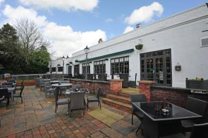 A restaurant or other place to eat at Himley House Hotel by Greene King Inns