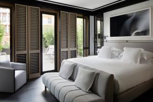 Ein Bett oder Betten in einem Zimmer der Unterkunft Seventy Barcelona