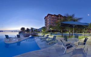 The swimming pool at or close to Angra dos Reis - Apartamentos com Vista para o mar OU para piscina Condomínio Porto Bali