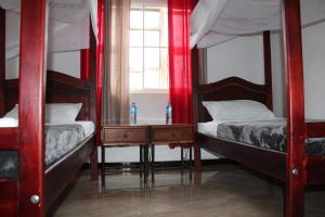 A bunk bed or bunk beds in a room at Entebbe Vine Inn