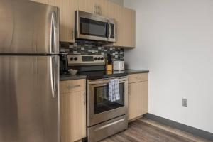 A kitchen or kitchenette at Upscale Waterfront 1BR Apt