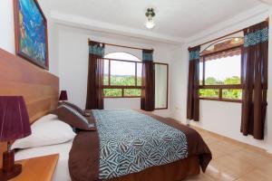 Cama o camas de una habitación en Twin Hotel Galápagos
