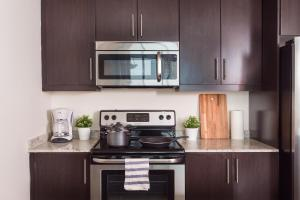 A kitchen or kitchenette at Walk to Convention Center Suite