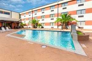 The swimming pool at or near Ramada by Wyndham Houston Intercontinental Airport South
