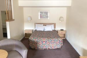 A bed or beds in a room at OYO Hotel Winnemucca NV I-80