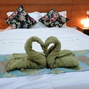 A bed or beds in a room at Juara Mutiara Resort