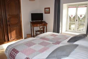 Ein Bett oder Betten in einem Zimmer der Unterkunft Le Tilleul de Ray