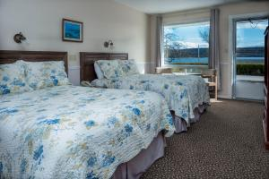 A bed or beds in a room at Cabot Trail Motel
