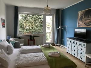Ein Bett oder Betten in einem Zimmer der Unterkunft Gästeträume Im Viertel