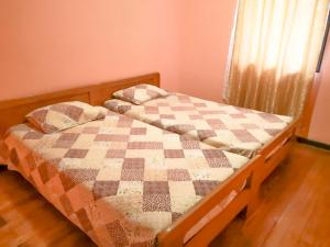 A bed or beds in a room at La Marsellesa
