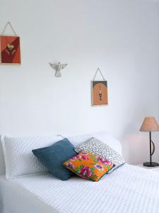 A bed or beds in a room at Casa Triplex em Angra dos Reis