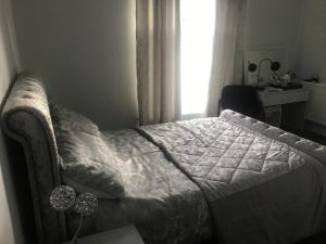 A bed or beds in a room at The Comat