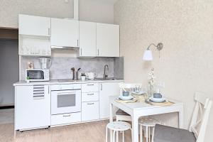 A kitchen or kitchenette at Апартаменты премиального формата и сервиса