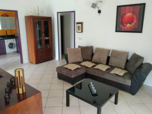 A seating area at Villa & Bungalow Fleur de Coco