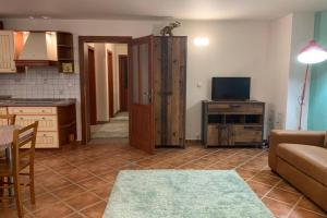 A television and/or entertainment center at GOLDEN KEY Stay to be happy near Karlovy Vary