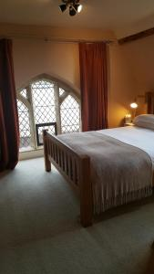 A bed or beds in a room at The Belfry at Yarcombe