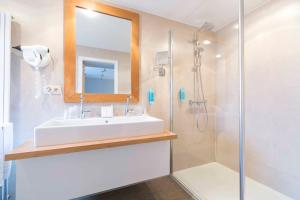 Een badkamer bij Hotel Lugano