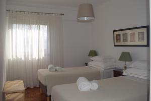 A bed or beds in a room at Vistas Sobre O Rio Tejo