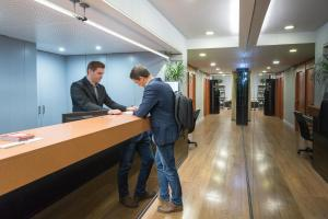 Лобби или стойка регистрации в Aparthotel Senator Barcelona