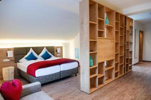 Ein Bett oder Betten in einem Zimmer der Unterkunft Gasthof Krone Ochsenfeld