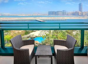 A balcony or terrace at Le Meridien Mina Seyahi Beach Resort & Marina