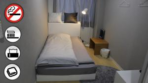 A bed or beds in a room at Hotel Zipang