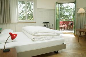 Ein Bett oder Betten in einem Zimmer der Unterkunft Militärkantine St. Gallen