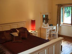 A bed or beds in a room at Orchid house