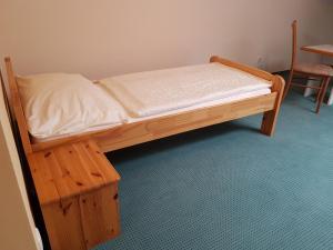 Ein Bett oder Betten in einem Zimmer der Unterkunft Gasthof s'Schatzkastl