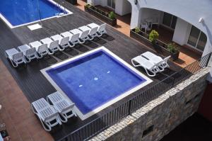 A view of the pool at Hotel Puerto Mar or nearby