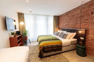 Ein Bett oder Betten in einem Zimmer der Unterkunft Hotel Dwars