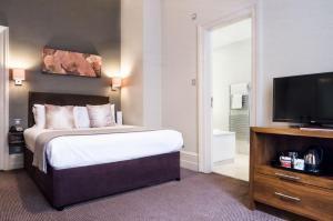 Кровать или кровати в номере The Met Hotel Leeds