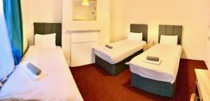 A bed or beds in a room at The Mill Hotel