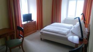 Ein Bett oder Betten in einem Zimmer der Unterkunft Hotel Schloss Fuchsmühl