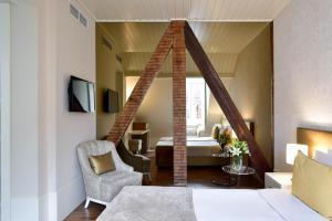 Ein Sitzbereich in der Unterkunft My Story Hotel Ouro