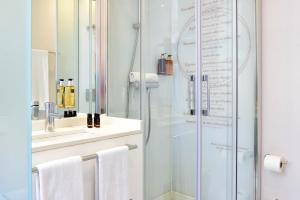 Ein Badezimmer in der Unterkunft My Story Hotel Ouro