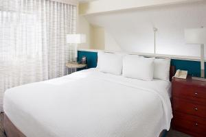 A bed or beds in a room at Residence Inn Ontario Airport