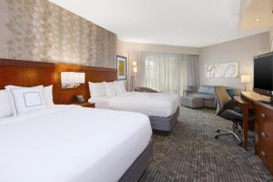 A bed or beds in a room at Courtyard by Marriott Oklahoma City Downtown