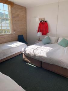 A bed or beds in a room at Sponars Chalet